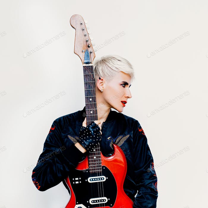 Blond girl with electro guitar. Rock style fashion