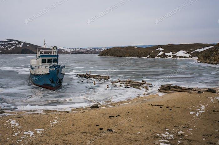 Scenic Landscape With Frozen Sea and Boat, Russia, Lake Baikal