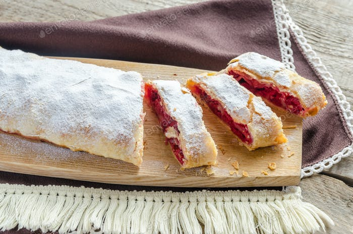 Cherry strudel on the wooden board