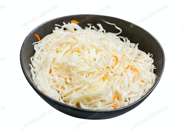 Russian sauerkraut in bowl isolated on white