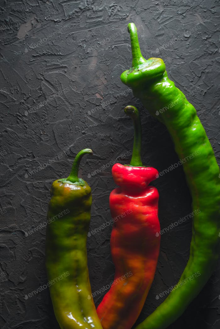 Red and green chili pepper on a gray background