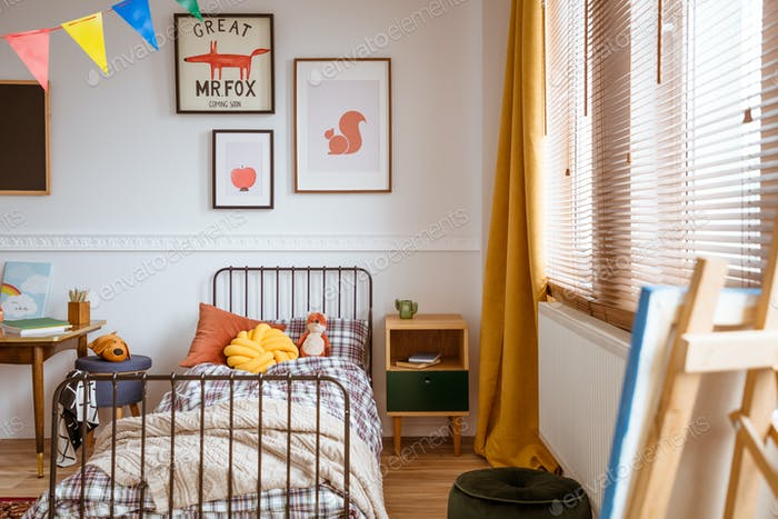 Single metal bed in fashionable bedroom interior for kid