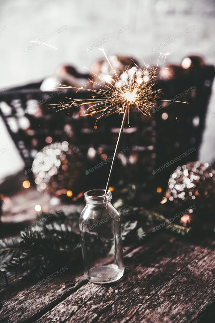New Year's, Christmas background with Christmas sparklers and Christmas-tree toys. Copy space