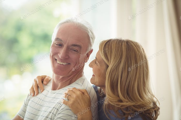 Smiling senior couple embracing