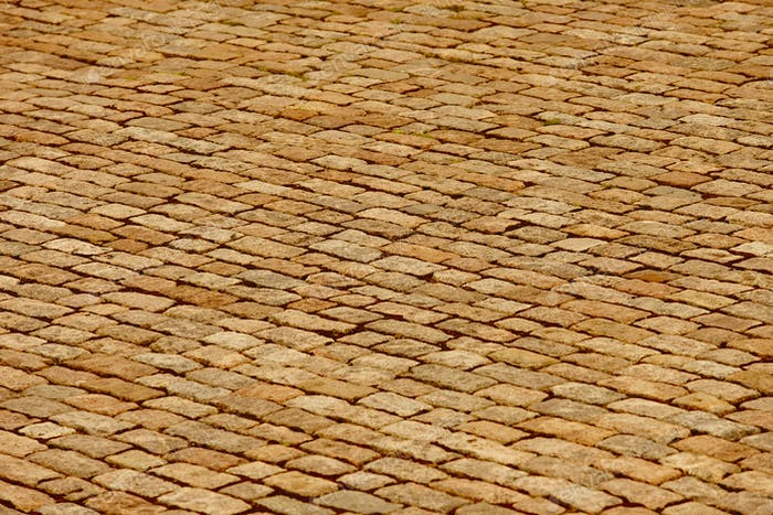 Antique warm tone paving stone. Copyspace. Horizontal