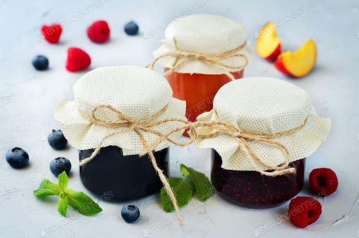 set of jams: raspberry, blueberry and peach