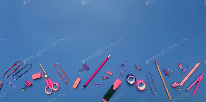 Flat lay of office, school stationery, pink color on blue background