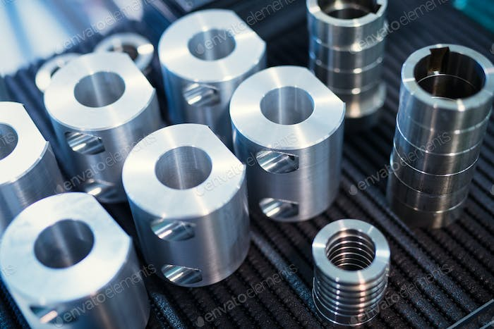 Industrial background from metal parts produced in metal industry