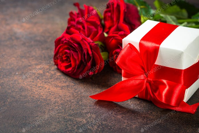 Holiday background with present and flower