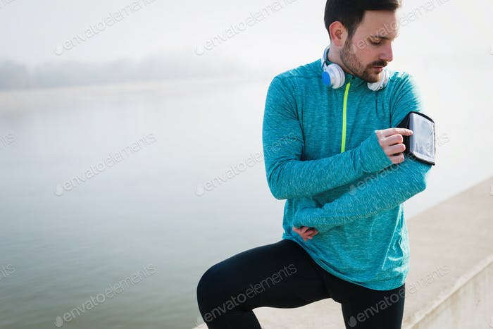 Determined sportsman fitness exercising by jogging outdoor