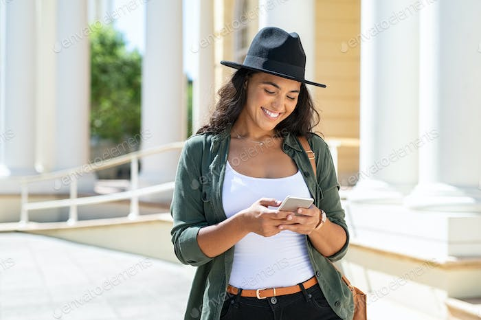 Latin woman using phone