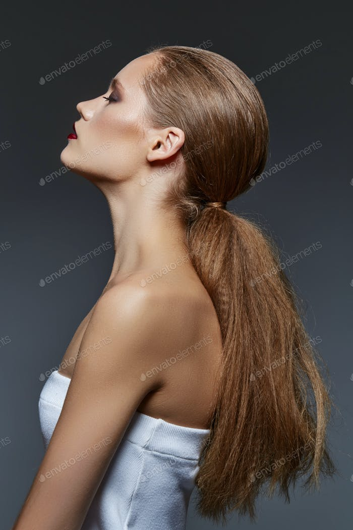 beautiful girl with long ponytail and red lips