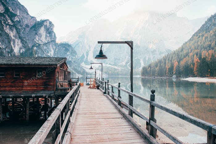 On the footpath. Good landscape with mountains. Touristic place with wooden building and pear
