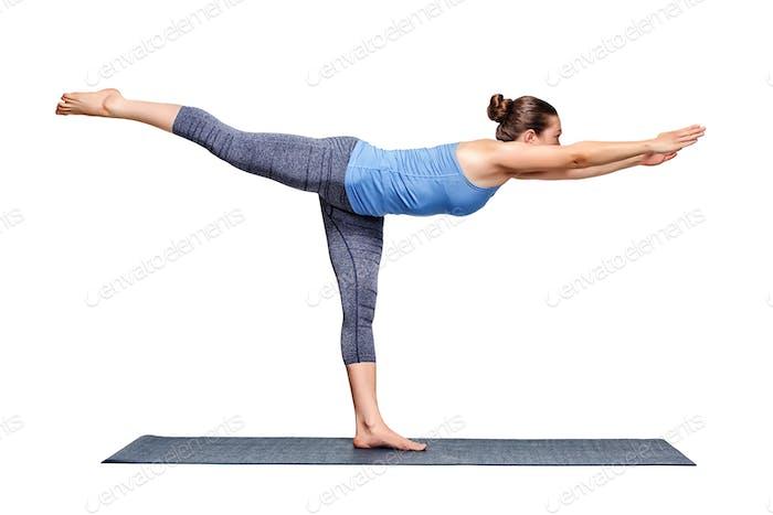 Sporty fit woman practices yoga asana utthita Virabhadrasana 3