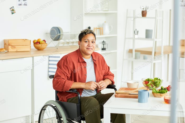 African disabled woman in the kitchen