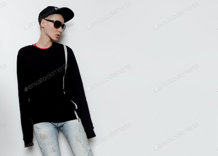 Tomboy Model Urban Outfit cap and Hoodie Fashion Trend