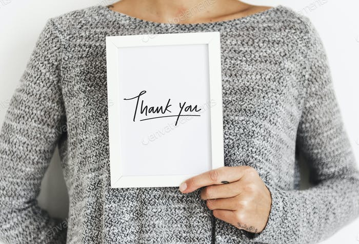 Woman holding a Thank You card