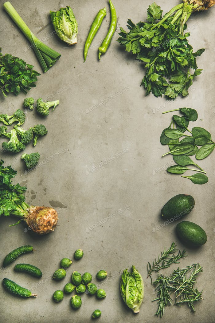 Healthy vegan ingredients layout over concrete table background, vertical composition