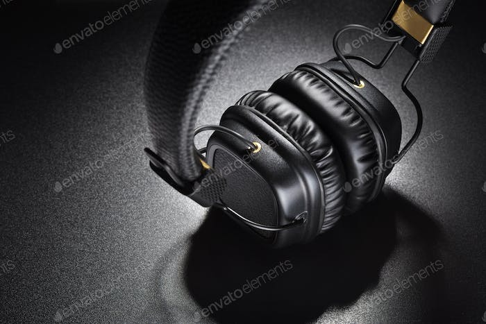 Wireless on-ear headphones on black background