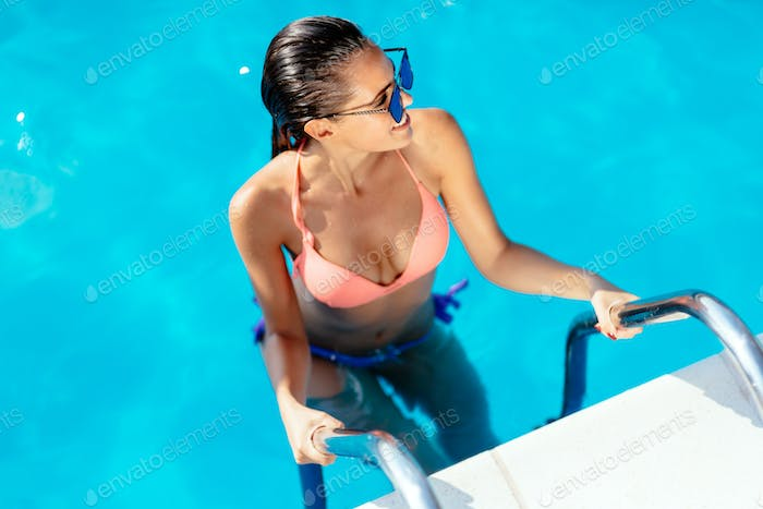 Beautiful sexy woman in pool