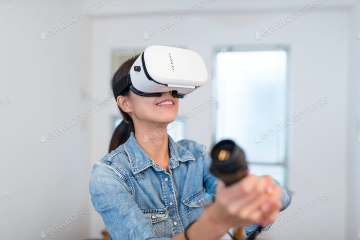 Woman play with VR at home