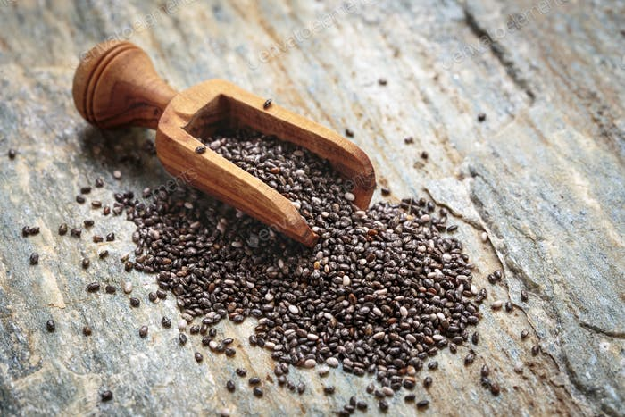 Chia seeds in scoop on stone