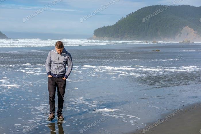 Lone man at USA Pacific coast beach