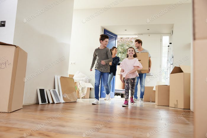 Thumbnail for Family Carrying Boxes Into New Home On Moving Day