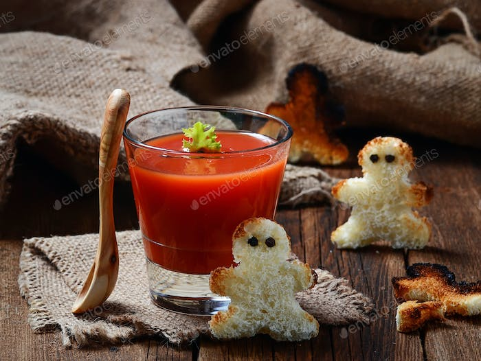 Halloween gazpacho soup and croutons that look like voodoo