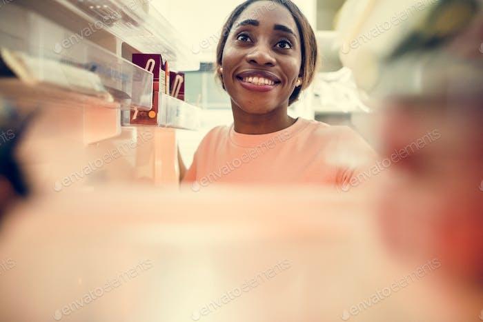 African descent woman open the fridge