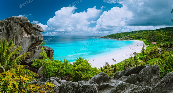 Picturesque panoramic shot of Grand Anse, La Digue island, Seychelles. Huge granite rock formation