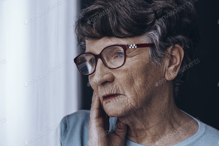 Elderly woman's face with glasses