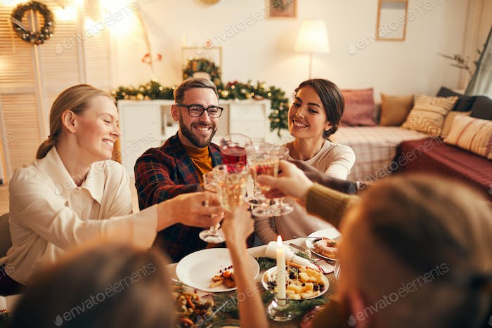 Friends Toasting at Dining Table