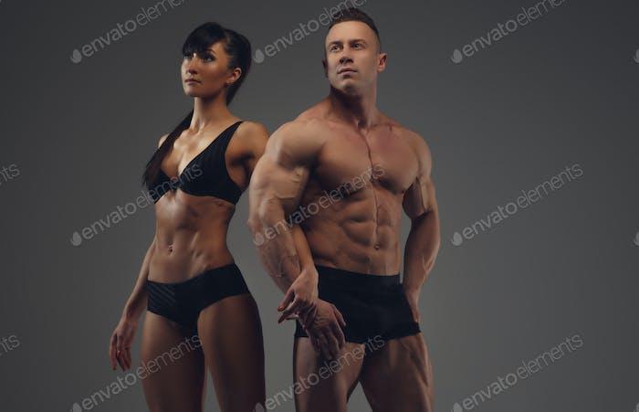Bodybuilder and his girlfriend in underwear.