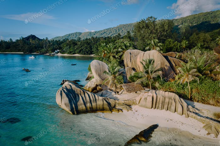 Aerial drone view of unique Anse Source D'Argent tropical beach, La Digue Seychelles. Luxury