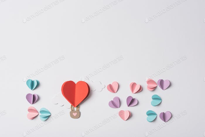 Love Lettering Made of Colorful Paper Hearts And Air Balloon With Clouds on White Background