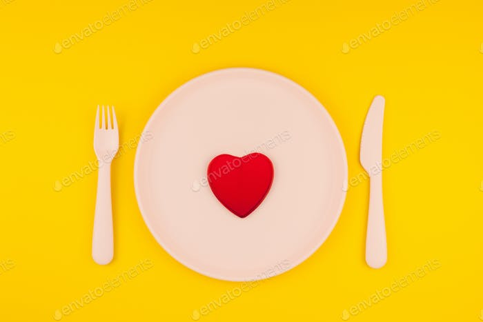 Red heart on serving table. Romantic concept