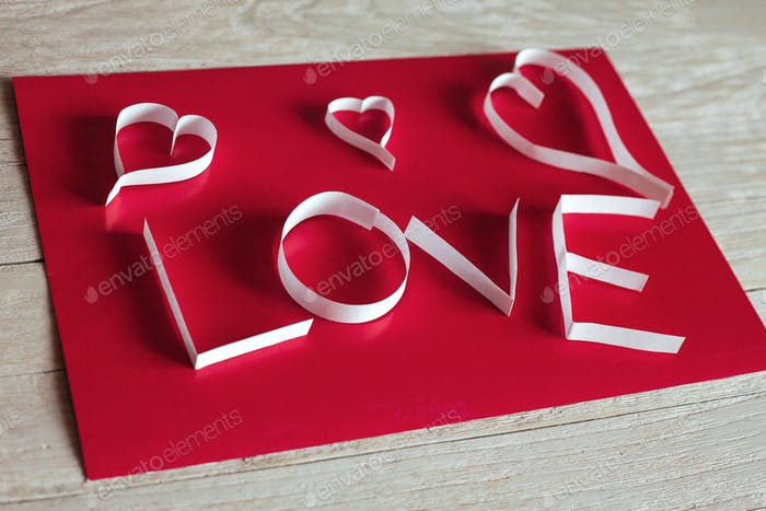 Valentine's day abstract background with cut paper heart
