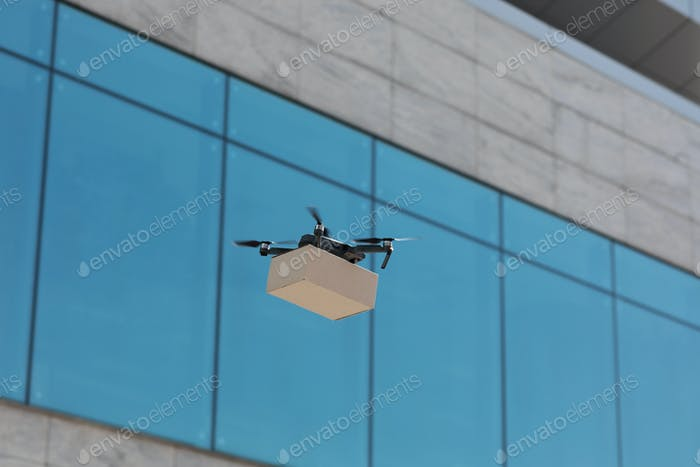 Modern quadrocopter makes express delivery of cardboard bo