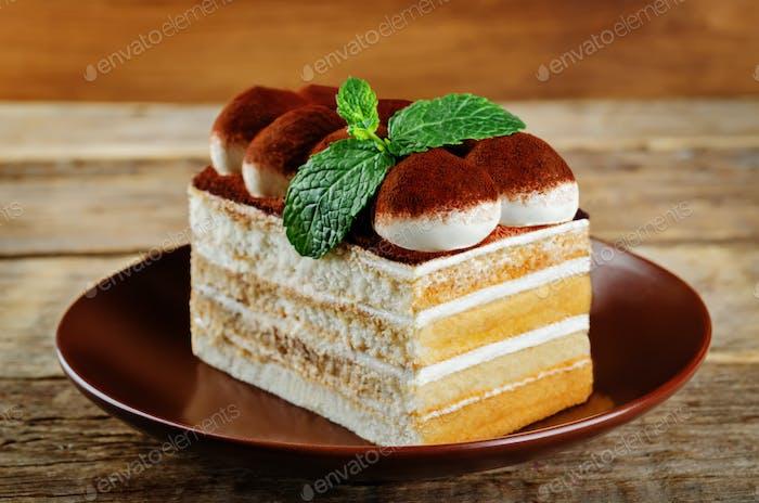 Tiramisu cake with mint leaves
