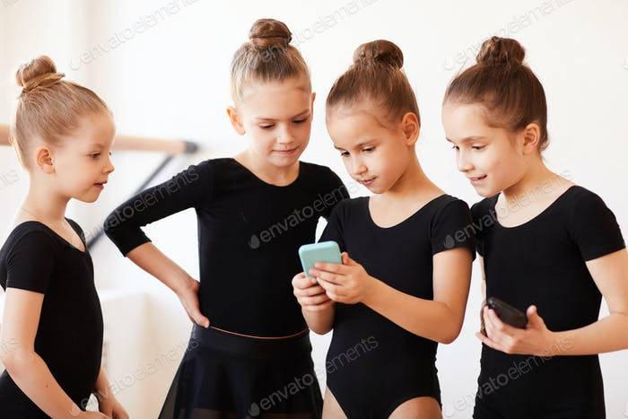Girls Using Smartphone at Practice