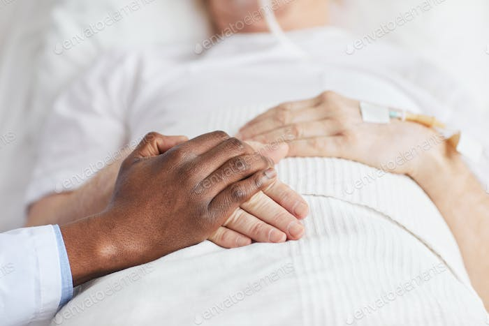 Doctor Holding Hands with Patient in Hospital Close Up