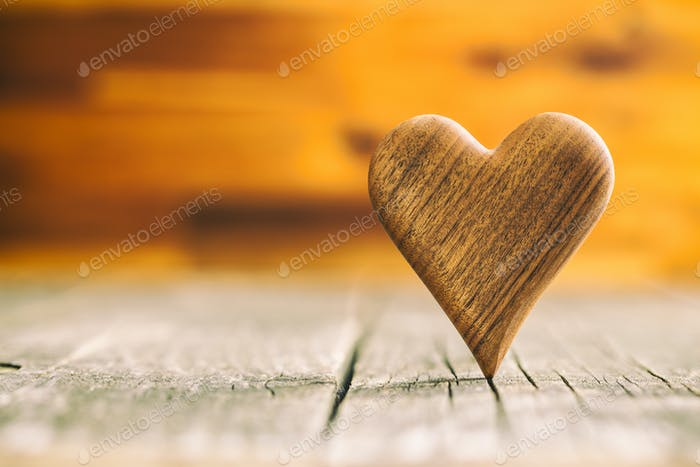 Wooden heart on wooden table.