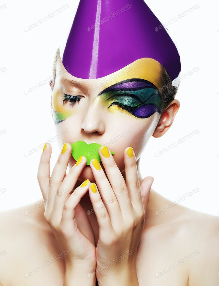 Studio portrait of young woman with colorful make up