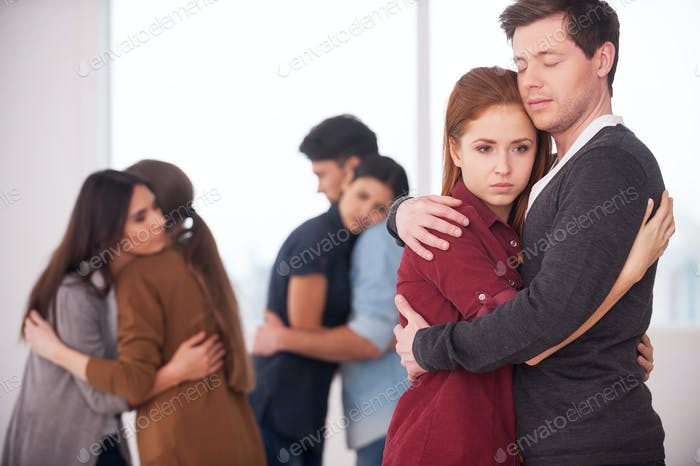 People we can trust. Group of depressed people hugging each other
