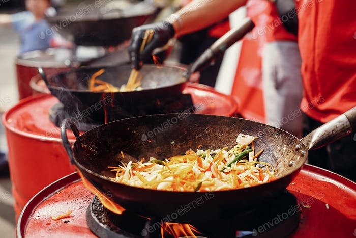 Fried chinese japanese noodles with vegetables and shrimps in wok