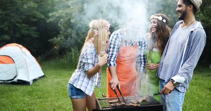 Group of friends making barbecue