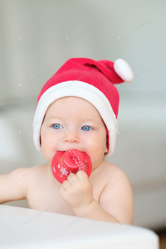 Baby christmas portrait in Santa Claus hat