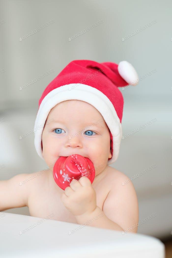 Baby Weihnachtsporträt in Santa Claus Hut