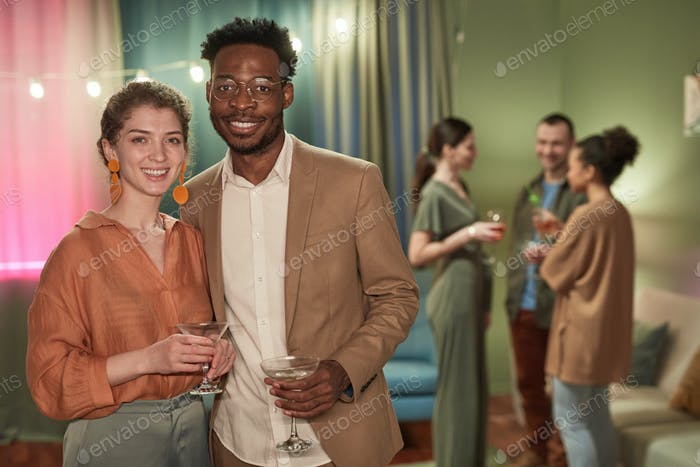 Couple Posing at Indoor Party